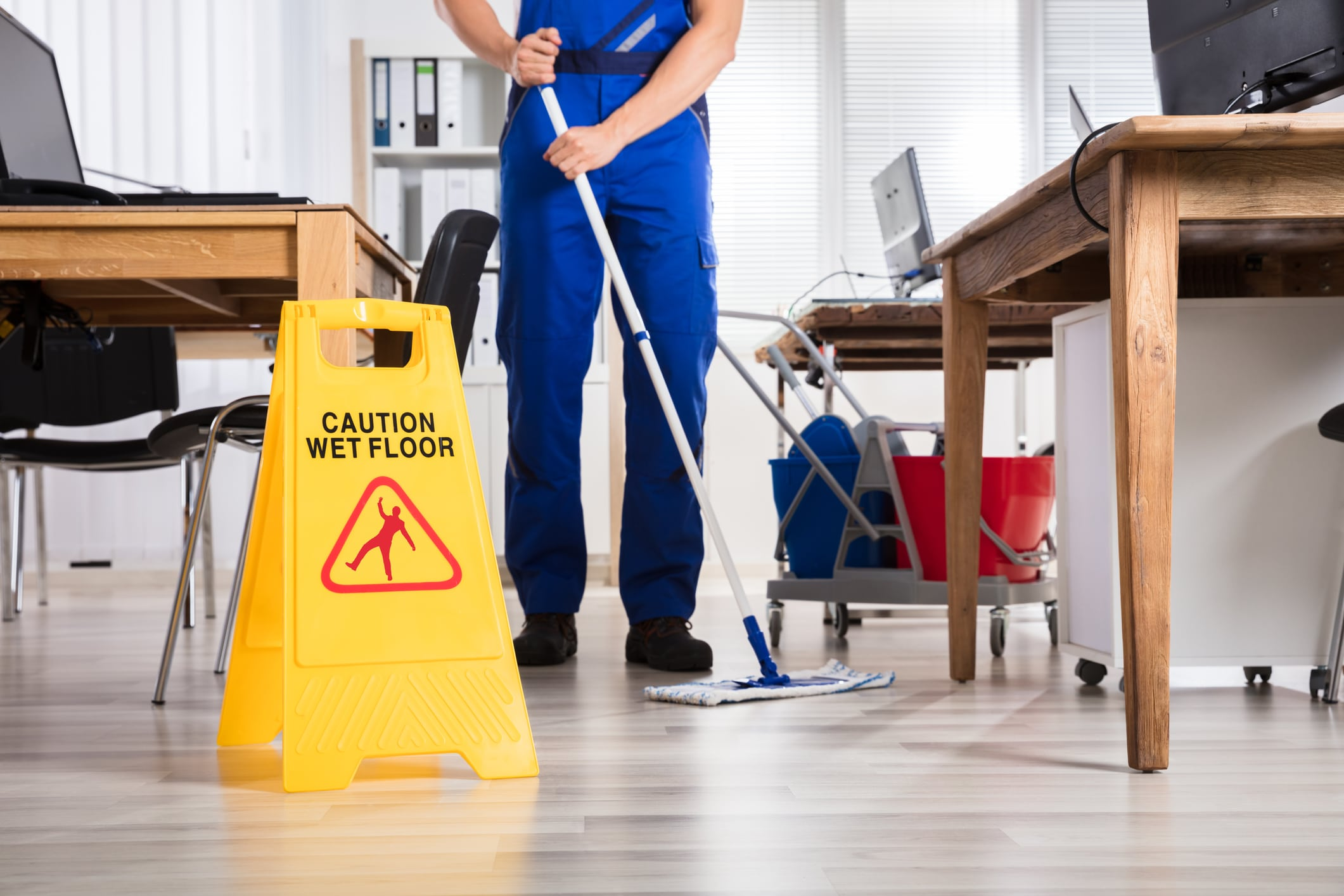business service contractor mopping the floors