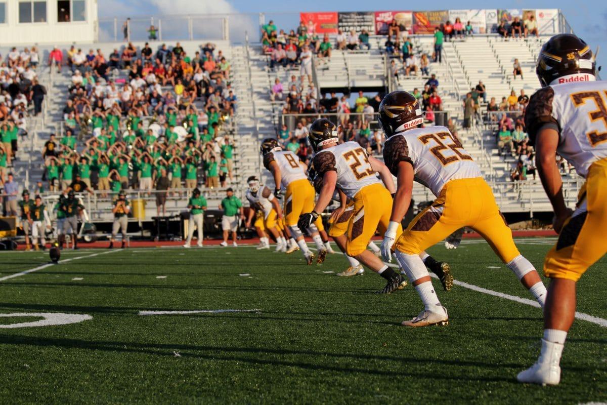 Football Kick off on clean field