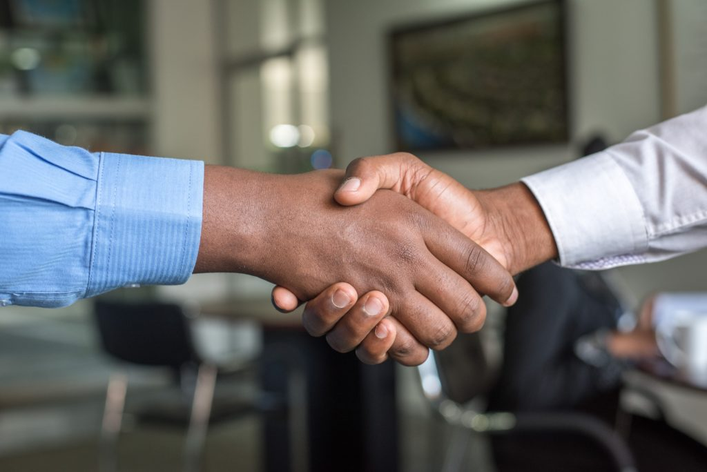 2 employees shaking hands